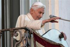 Pope Benedict XVI waves as he appears for the last time at the balcony of his summer residence in Castelgandolfo, south of Rome, February 28, 2013. REUTERS/Max Rossi