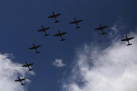 Super Tucano combat planes fly during a ceremony to mark the 93rd anniversary of the Colombian Air Force at the military base in Bogota November 9, 2012. REUTERS/John Vizcaino