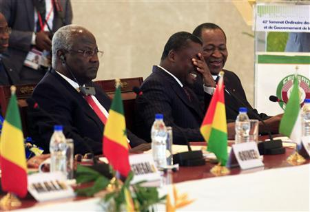 Sierra Leone's President Ernest Bai Koroma (L), Togo's President Faure Gnassingbe (C) and Burkina Faso's President Blaise Compaore attend a summit of West African regional bloc ECOWAS on the crisis in Mali and Guinea Bissau, at the Fondation Felix Houphouet Boigny in Yamoussoukro February 28, 2013. REUTERS/Thierry Gouegnon