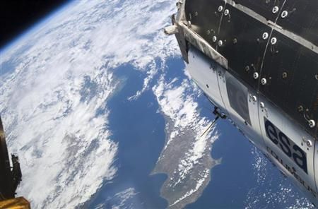 The island of Cyprus is partially visible among the clouds with the European Space Agency's Columbus module in the foreground in this image provided by NASA and taken April 8, 2010. REUTERS/NASA/Handout