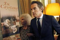 """Spain's Duchess of Alba Cayetana Fitz-James Stuart y Silva (L) and her husband Alfonso Diez pose before a presentation of her new biography """"Yo Cayetana"""" in Estoril, on the outskirts of Lisbon, February 8, 2012. REUTERS/Hugo Correia"""