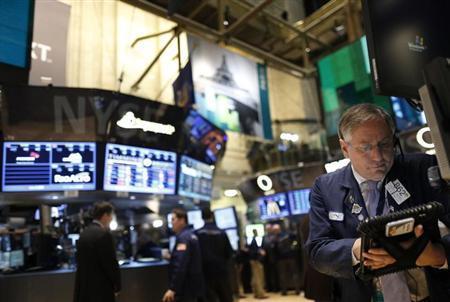 Trader Warren Meyers works on the floor of the New York Stock Exchange, March 1, 2013. REUTERS/Brendan McDermid