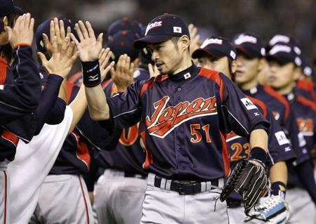 Japan's Ichiro Suzuki (C) celebrates with team mates after defeating South Korea during the World Baseball Classic (WBC) Tokyo round in Tokyo Dome in this file photo taken March 7, 2009. REUTERS/Toru Hanai