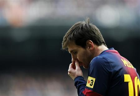 Barcelona's Lionel Messi reacts during their Spanish first division soccer match against Real Madrid at Santiago Bernabeu stadium in Madrid March 2, 2013. REUTERS/Susana Vera
