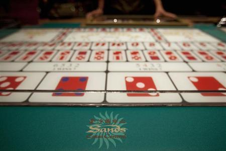 A logo of Sands is seen on a gaming table inside a casino on the opening day of the Sheraton Macao hotel at Sands Cotai Central in Macau September 20, 2012. Las Vegas Sands deceived a Nevada court in an attempt to stall a lawsuit by the former head of its Macau operations, a state judge ruled on Friday, fining the casino operator and abridging its right to object in a fight over key evidence. REUTERS/Tyrone Siu
