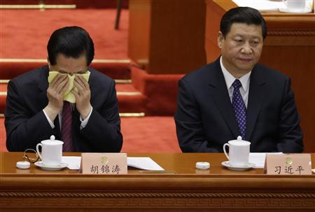 China's President Hu Jintao wipes his face next to China's Communist Party Chief Xi Jinping during the opening ceremony of Chinese People's Political Consultative Conference (CPPCC) at the Great Hall of the People in Beijing, March 3, 2013. REUTERS/Jason Lee