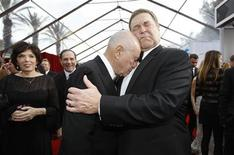 "Actors John Goodman (R) and Alan Arkin from ""Argo"" embrace at the 19th annual Screen Actors Guild Awards in Los Angeles, California in this January 27, 2013 file photograph. A new show called ""Alpha House,"" whose pilot filmed in New York late February 2013, has many of the ingredients necessary for television success. Goodman, coming off notable roles in Oscar-winning movies ""Argo"" and ""The Artist,"" is the star. REUTERS/Mario Anzuoni/Files"