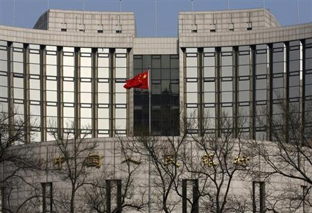 A Chinese national flag is seen at the headquarters of the central bank of China in Beijing February 20, 2013. REUTERS/Kim Kyung-Hoon