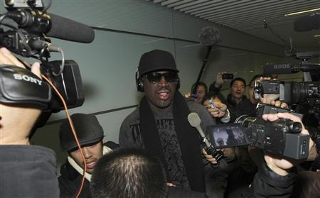 Former NBA star Dennis Rodman (C) talks to journalists as he arrives at the Beijing Capital International Airport after his visit to Democratic People's Republic of Korea (DPRK), March 1, 2013. REUTERS/China Daily
