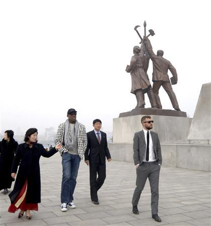 Former NBA star Dennis Rodman (3rd R) and his company visit the Tower of Juche Idea in Pyongyang in this picture released by North Korea's KCNA news agency on March 1, 2013. REUTERS/KCNA