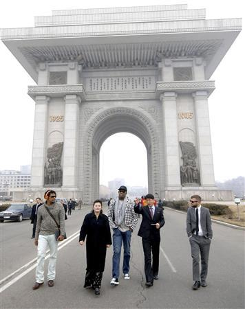 Former NBA star Dennis Rodman (C) visits the Arch of Triumph in Pyongyang in this picture released by North Korea's KCNA news agency on March 1, 2013. REUTERS/KCNA