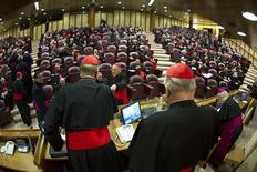 Cardinals attends a meeting at the Synod Hall in the Vatican March 4, 2013. Preparations for electing Roman Catholicism's new leader begin in earnest on Monday as the College of Cardinals opens daily talks to sketch an identikit for the next pope and ponder who among them might fit it. REUTERS/Osservatore Romano