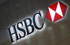 A HSBC logo is seen above the entrance to a HSBC bank branch in midtown Manhattan in New York City, December 11, 2012. REUTERS/Mike Segar