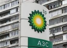 A BP logo is seen in front of an apartment block near a petrol station in Moscow October 22, 2012. REUTERS/Maxim Shemetov