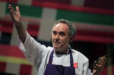 "El Bulli restaurant head chef Ferran Adria gestures while holding a shrimp as he speaks during a conference at the ""Mistura"" gastronomic fair in Lima in this September 11, 2011 file photograph. REUTERS/Pilar Olivares/Files"