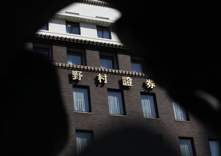 The headquarters of Nomura Securities is seen through a decoration of a bridge in Tokyo March 5, 2013. REUTERS/Yuya Shino