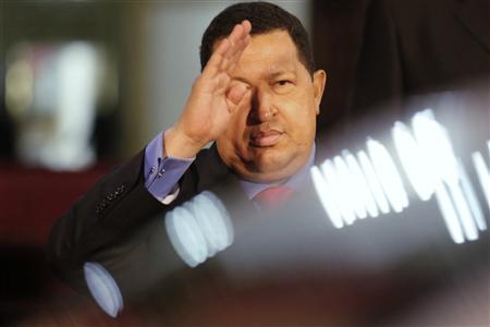 Venezuela's President Hugo Chavez waves to Rosneft Chief Executive Igor Sechin (not pictured) of Russia after a visit at Miraflores Palace in Caracas September 27, 2012. REUTERS-Jorge Silva