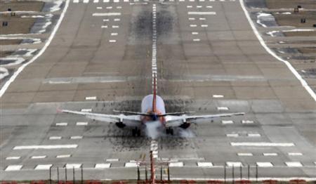 A Southwest Airlines jet lands at the Lambert - St. Louis International Airport, in St. Louis, Missouri, March 4, 2013. REUTERS/Tom Gannam