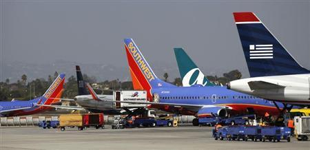 Airplanes are seen parked at Los Angeles International Airport in Los Angeles, California March 4, 2013. REUTERS/Mario Anzuoni