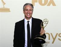 """Television host Jon Stewart holds the Emmy award for the """"The Daily Show With Jon Stewart"""" after winning for outstanding variety, music or comedy series, backstage at the 63rd Primetime Emmy Awards in Los Angeles September 18, 2011. REUTERS/Lucy Nicholson"""