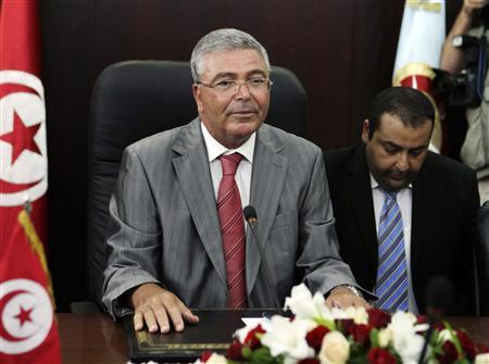 Tunisian Defence Minister Abdelkarim Zbidi speaks during a meeting with U.S. Defense Secretary Leon Panetta (not in picture) in Tunis July 30, 2012. REUTERS/Zoubeir Souissi