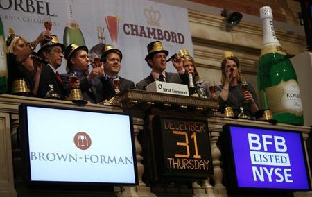 Executives from Brown Forman, the makers of Korbel Chanmpagne, toast as they ring the closing bell on the final trading session of 2009 at the New York Stock Exchenge December 31, 2009. REUTERS/Mike Segar