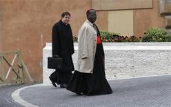 Cardinal Laurent Monsengwo Pasinya, of the Democratic Republic of Congo (R), and Cardinal Joao Braz de Aviz of Brazil arrive for a meeting at the Synod Hall in the Vatican March 6, 2013. Catholic cardinals said on Tuesday they wanted time to get to know each before choosing the next pope and meanwhile would seek more information on a secret report on alleged corruption in the Vatican. REUTERS/Tony Gentile (VATICAN - Tags: RELIGION)
