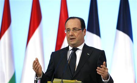 France's President Francois Hollande gestures during a news conference at the Visegrad Group meeting in Warsaw March 6, 2013. REUTERS/Kacper Pempel