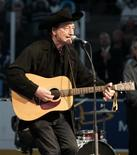 """Canadian singing legend Stompin' Tom Connors sings """"The Hockey Song"""" before the start of the NHL game between the Toronto Maple Leafs and the Ottawa Senators in Toronto in this October 5, 2005 file photo. Connors died March 6, 2013, aged 77. REUTERS/Mike Cassese/Files"""