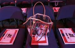 A purse containing the latest issue of Time magazine, with Republican presidential candidate Mitt Romney on the cover, is seen during the second day of the Republican National Convention in Tampa, Florida August 28, 2012. REUTERS/Eric Thayer