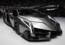 The Veneno car is pictured on the Lamborghini booth during the second media day of the 83rd Geneva Car Show at the Palexpo Arena in Geneva March 6, 2013. REUTERS/Denis Balibouse