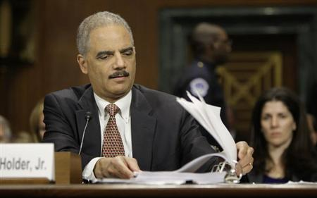 U.S. Attorney General Eric Holder refers to his notes during testimony before the Senate Judiciary Committee on Capitol Hill in Washington, March 6, 2013. REUTERS/Jonathan Ernst