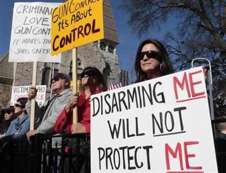 Marylou Harris holds a sign as she listens to speakers during the Guns Across America pro-gun rally at the State Capitol in Atlanta, Georgia, January 19, 2013. REUTERS/Tami Chappell