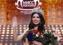 "Elmira Abdrazakova from Mezhdurechensk waves after winning the annual national ""Miss Russia"" beauty pageant at the Barvikha Luxury Village Concert Hall outside Moscow March 2, 2013. REUTERS/Maxim Shemetov"