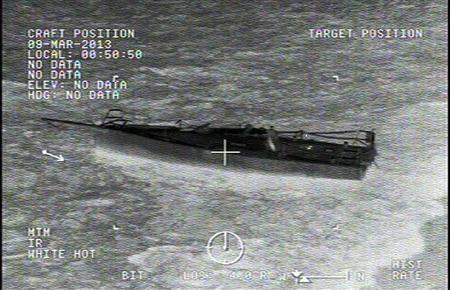 A stricken sailboat, the Uncontrollable Urge, is pictured near San Clemente Island, California in this still image capture from an infrared Coast Guard handout video taken March 9, 2013. REUTERS/USCG/Handout