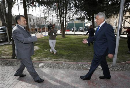 U.S. Secretary of Defense Chuck Hagel greets Afghanistan's Defence Minister Bismallah Khan Mohammadi at the ISAF (International Security Assistance Force) headquarters in Kabul, March 10, 2013. REUTERS/Jason Reed