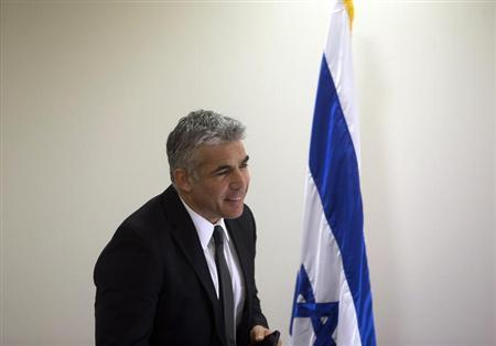 Yair Lapid, a former television anchorman who leads the new middle-of-the-road Yesh Atid party, attends a party meeting at parliament in Jerusalem February 11, 2013. REUTERS/Ronen Zvulun