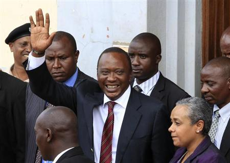 President elect Uhuru Kenyatta greets his supporters in the company of his wife Margaret soon after attending a church service in his rural home town of Gatundu, north of capital Nairobi, March 10, 2013. REUTERS/Noor Khamis