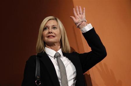 Actress Olivia Newton John waves as she arrives at a photocall of the movie ''A Few Best Men'' by director Stephan Elliot at the Rome Film Festival October 28, 2011. REUTERS/Alessandro Bianchi