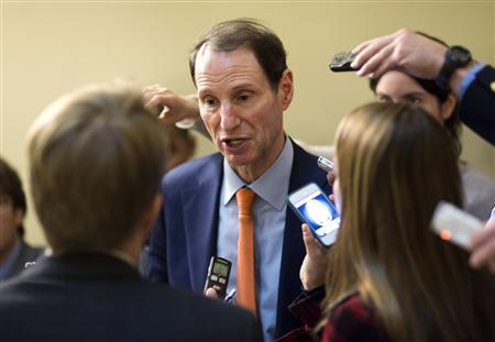 U.S. Senator Ron Wyden (D-OR) speaks to the media after the Democratic policy luncheon on Capitol Hill in Washington on December 18, 2012. REUTERS/Joshua Roberts