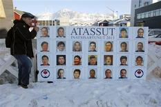 A party worker sets up a campaign poster in the centre of Nuuk, March 11, 2013. REUTERS/Alistair Scrutton (GREENLAND - Tags: POLITICS ELECTIONS)
