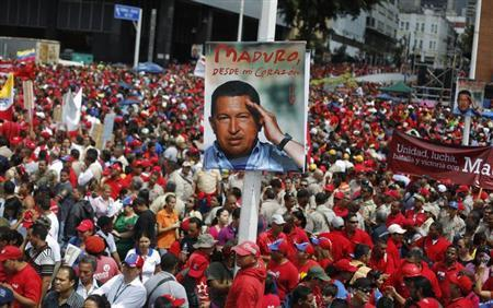 Supporters of Venezuela's acting President Nicolas Maduro attend a rally outside the national election board, as Maduro registered as a candidate for president in the April 14 election, in Caracas March 11, 2013. REUTERS/Tomas Brav