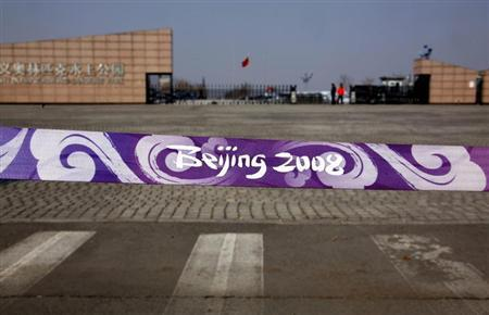 A barrier tape bearing the 2008 Beijing Olympic Games logo stands out at the front of the deserted and unmaintained former venue for the 2008 Beijing Olympic Games rowing competition, located on the outskirts of Beijing March 27, 2012. REUTERS/David Gray