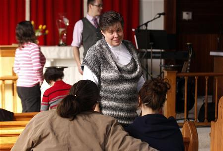 Stephanie Abell (C) talks with other members of the congregation before the start of their Sunday morning church service at the Open Door Community Fellowship Church in Louisville, Kentucky, March 2, 2013. REUTERS/John Sommers II