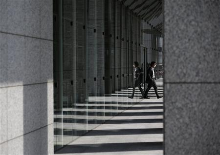 A man walks out from an office building in Tokyo March 13, 2013. REUTERS/Issei Kato