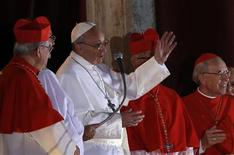 Newly elected Pope Francis (2nd L) appears on the balcony of St. Peter's Basilica after being elected by the conclave of cardinals, at the Vatican, March 13, 2013. REUTERS/Alessandro Bianchi