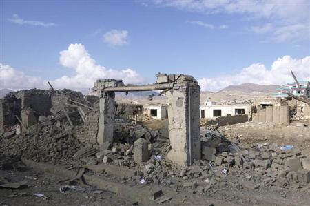 Debris from a bomb blast lies in Wardak province November 23, 2012. REUTERS/Stringer/Files