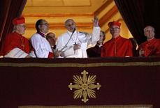 Newly elected Pope Francis (C), Cardinal Jorge Mario Bergoglio of Argentina appears on the balcony of St. Peter's Basilica after being elected by the conclave of cardinals, at the Vatican, March 13, 2013. White smoke rose from the Sistine Chapel chimney and the bells of St. Peter's Basilica rang out on Wednesday, signaling that Roman Catholic cardinals had elected a pope to succeed Benedict XVI. REUTERS/Tony Gentile (VATICAN - Tags: RELIGION)