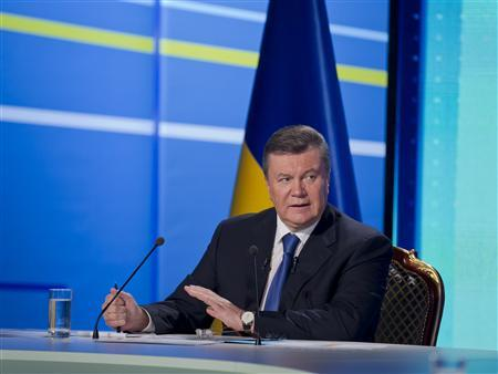 Ukrainian President Viktor Yanukovich takes part in a televised question-and-answer session in Kiev, February 22, 2013. REUTERS/Andriy Mosienko/Presidential Press Service/Handout