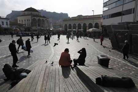 People walk at Monastiraki square in central Athens January 3, 2013. REUTERS/John Kolesidis